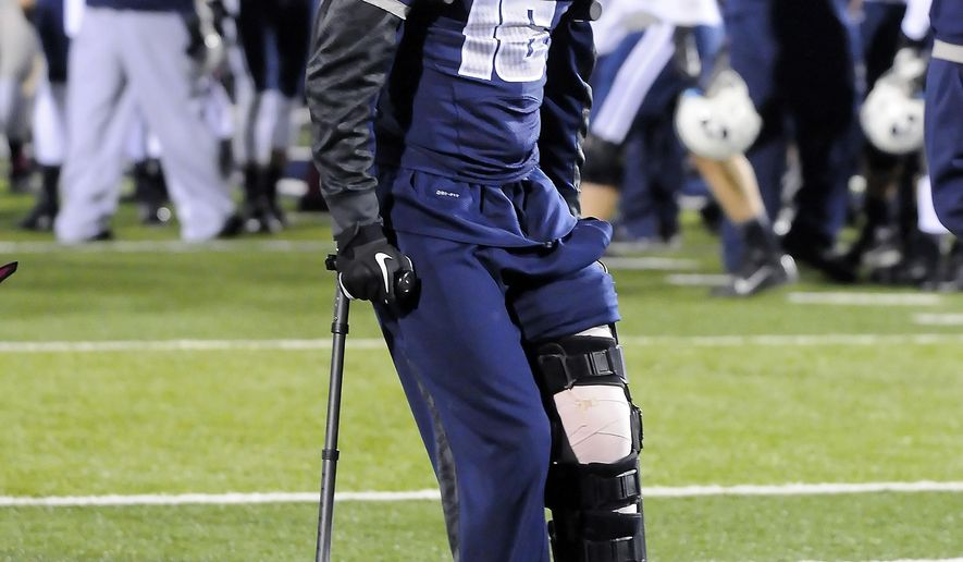 FILE - In this Oct. 4, 2013, file photo, Utah State quarterback Chuckie Keeton walks off the field after Utah State lost to BYU 31-14 in an NCAA college football game in Logan, Utah. Keeton says he won't be too overwhelmed on Sunday when the Aggies visit Tennessee. Keeton just isn't the type to get rattled by 100,000-plus fans: The dual-threat senior quarterback for the Aggies is anxious to make his return from injury before a big crowd and on a national stage. (AP Photo/The Herald Journal, Eli Lucero, File)