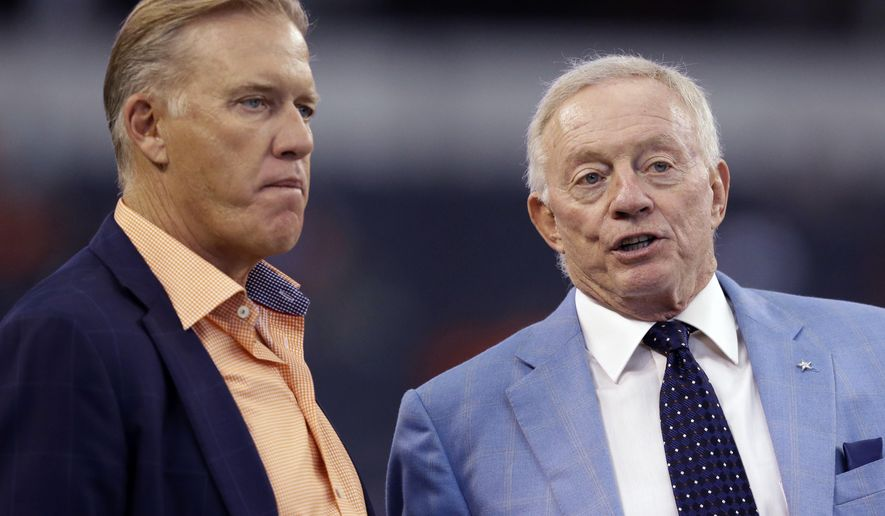 John Elway, Executive Vice President of Football Operations and General Manager of the Denver Broncos, left, talks with Dallas Cowboys team owner Jerry Jones, right, before a NFL preseason football game, Thursday, Aug. 28. 2014, in Arlington, Texas. (AP Photo/LM Otero)