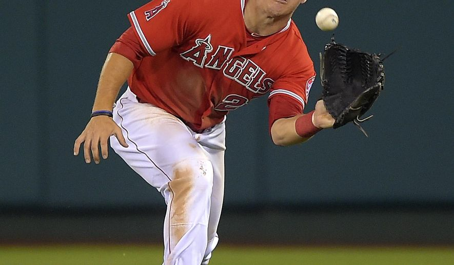 Los Angeles Angels center fielder Mike Trout makes a catch on a fly ball hit by Oakland Athletics' Josh Reddick during the seventh inning of a baseball game, Thursday, Aug. 28, 2014, in Anaheim, Calif. (AP Photo/Mark J. Terrill)