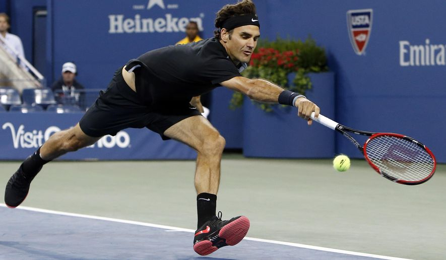 Roger Federer, of Switzerland, stretches in vain to return a shot to Sam Groth, of Australia, during the second round of the U.S. Open tennis tournament Friday, Aug. 29, 2014, in New York. (AP Photo/Jason DeCrow)