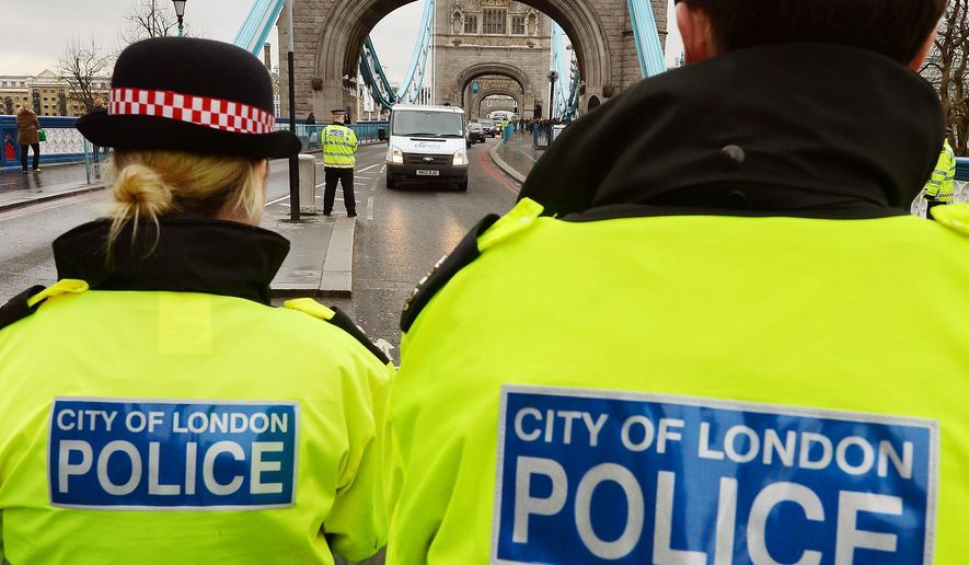 The City of London Police mount a large scale operation on Tower Bridge at the launch of project Servator, February 10, 2014. The operation aims to deter, disrupt and detect criminal and terrorist activity earlier and more actively. (Associated Press) ** FILE **