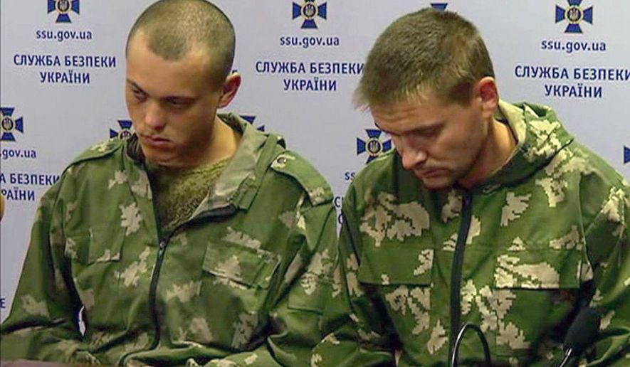 Captured Russian paratroopers are seen in this image taken from video in Kiev on Wednesday Aug. 27. 2014. Ten Russian paratroopers were captured this week in Ukraine, adding to a growing body of evidence that Russia, despite its denials, is sending regular troops and weapons to support the separatists in their increasingly deadly fight against Ukrainian forces. (AP Photo/Channel 5) UKRAINE OUT TV OUT