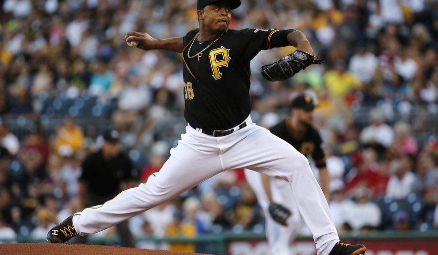 Pittsburgh Pirates starting pitcher Edinson Volquez (36) delivers during the first inning of a baseball game against the Cincinnati Reds in Pittsburgh Friday, Aug. 29, 2014. (AP Photo/Gene J. Puskar)