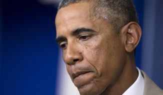 President Barack Obama pauses while speaking about the economy, Iraq, and Ukraine, Thursday, Aug. 28, 2014, in the James Brady Press Briefing Room of the White House in Washington, before convening a meeting with his national security team on the militant threat in Syria and Iraq. (AP Photo/Manuel Balce Ceneta)