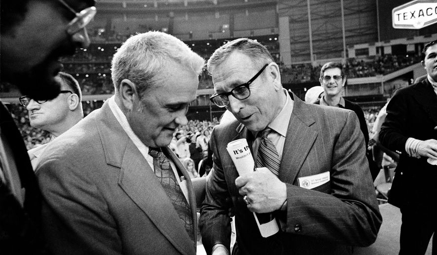 """FILE - In this March 27, 1971, file photo, Villanova University basketball coach Jack Kraft, left, congratulates UCLA coach John Wooden after Wooden's Bruins defeated Villanova, 68-62, to win the NCAA championship in Houston, Texas. Villanova officials say former head basketball coach John """"Jack"""" Kraft, who led the Wildcats to 238 victories over a dozen seasons and a 1971 title game appearance, died Thursday, Aug. 28, 2014, in New Jersey. He was 93. (AP Photo/File)"""