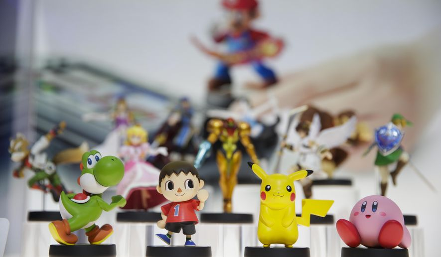 "In this June 10, 2014 file photo, amiibo characters for Wii U are on display at the Nintendo booth during the Electronic Entertainment Expo, in Los Angeles. Pikachu and Link will be among the first characters coming to ""amiibo."" Nintendo announced the 12 characters on Friday, Aug. 29, 2014, that will be part of its upcoming toys-meet-game franchise set for release later this year. (AP Photo/Jae C. Hong, File)"
