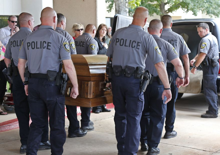 The casket of Oklahoma City canine officer K-9 Kye, is carried into a waiting hearse following funeral services for the dog in Oklahoma City, Thursday, Aug. 28, 2014. K-9 Kye died Aug. 25 after being stabbed by a burglary suspect on Aug. 24. (AP Photo/Sue Ogrocki)