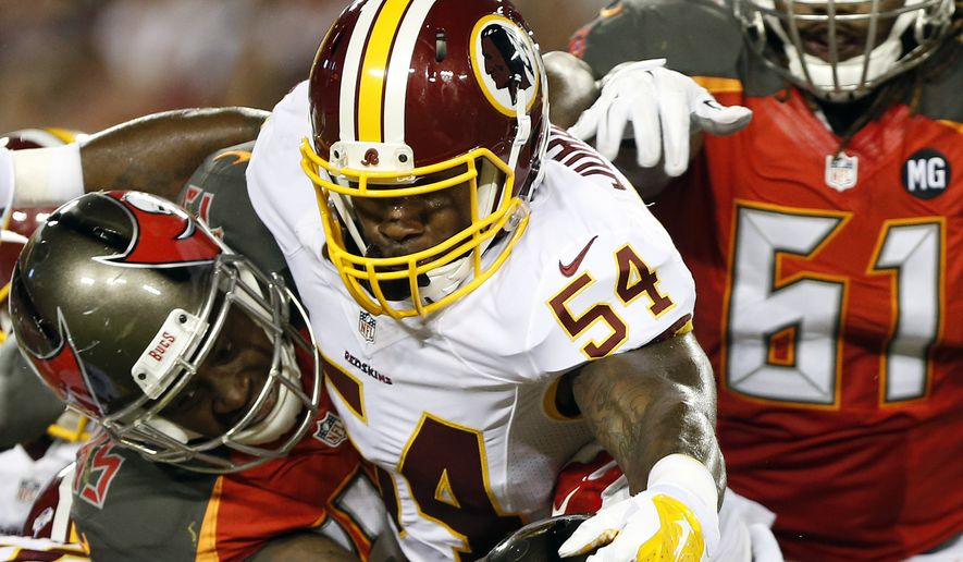 Washington Redskins inside linebacker Akeem Jordan (54) stops Tampa Bay Buccaneers running back Jeff Demps (32) during the second quarter of an NFL preseason football game Thursday, Aug. 28, 2014, in Tampa, Fla. (AP Photo/Brian Blanco)