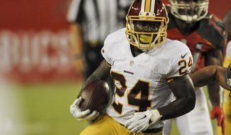 Washington Redskins running back Silas Redd (24) carries the ball against the Tampa Bay Buccaneers during a NFL preseason football game Thursday, Aug. 28, 2014 in Tampa, Fla. (AP Photo/Steve Nesius)