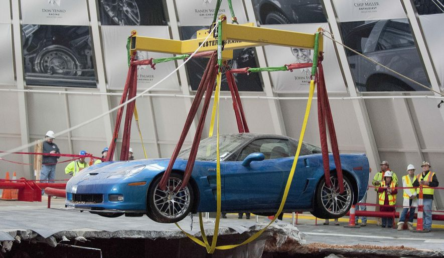 FILE - In this March 3, 2014 file photo, one of eight Chevrolet Corvettes is removed from a sinkhole in the Skydome at the National Corvette Museum in Bowling Green, Ky.  Officials at the Corvette Museum are scheduled to meet and expected to decide what to do about a sinkhole that opened up earlier this year and boosted visitors. Options are to leave it, completely fill it in and partially fill it in. (AP Photo/Daily News, Alex Slitz)