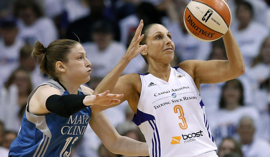 Phoenix Mercury's Diana Taurasi (3) tries to keep the ball away from Minnesota Lynx's Lindsay Whalen, left, during the first half in Game 1 of the WNBA Western Conference Finals basketball game, Friday, Aug. 29, 2014, in Phoenix. (AP Photo/Ross D. Franklin)