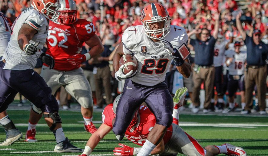 UTEP's Aaron Jones (29) runs in the first touchdown as he gets past the New Mexico defense, including Cole Juarez (52), during the first half of a football game Saturday, Aug. 30, 2014, in Albuquerque, N.M. (AP Photo/The Albuquerque Journal, Aaron Sweet)