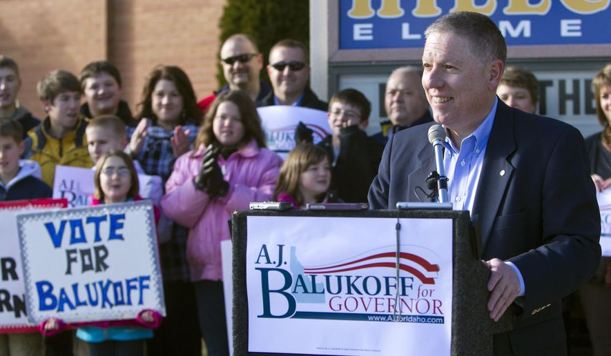 ADVANCE FOR USE SATURDAY, AUG. 30, 2014, AND THEREAFTER- File - In this Dec. 3, 2013 file photo, Idaho businessman and school board member A.J. Balukoff, right, announces he is running as a Democrat for governor in front of Hillcrest Elementary in Boise, Idaho. Gov. Butch Otter, who is seeking a third-term, could face a tight race against Democratic challenger Balukoff, a millionaire who has said he'll spend as much as he needs to win. (AP Photo/The Idaho Statesman, Darin Oswald, File)  LOCAL TV OUT (KTVB 7)