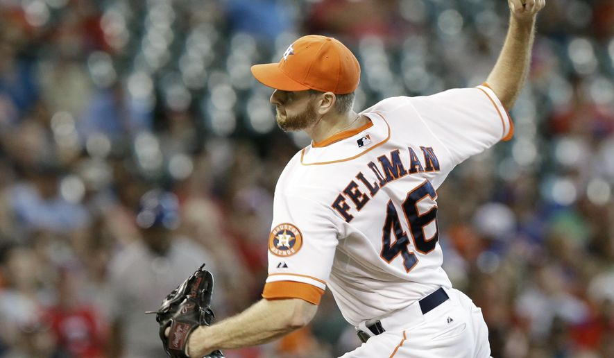 Houston Astros' Scott Feldman delivers a pitch against the Texas Rangers in the first inning of a baseball game Saturday, Aug. 30, 2014, in Houston. (AP Photo/Pat Sullivan)