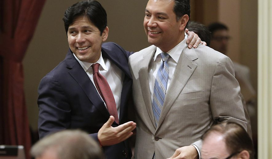 State Senators Kevin de Leon, D-Los Angeles, left, and Sen. Alex Padilla, D-Los Angeles, celebrate after lawmakers approved Padilla's bill to ban single-use plastic bags at the Capitol in Sacramento, Calif., Friday, Aug. 29, 2014. By a 22-15 vote, the Senate approved SB270  that makes California the first state to impose a statewide ban on single-use plastic bags. The bill now goes to  Gov Jerry Brown.  De Leon had previously opposed the bill, but gave his support after protections were added for plastic bag manufacturers.(AP Photo/Rich Pedroncelli)