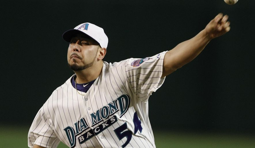 Arizona Diamondbacks starting pitcher Vidal Nuno throws in the first inning during a baseball game against the Colorado Rockies, Saturday, Aug. 30, 2014, in Phoenix. (AP Photo/Rick Scuteri)