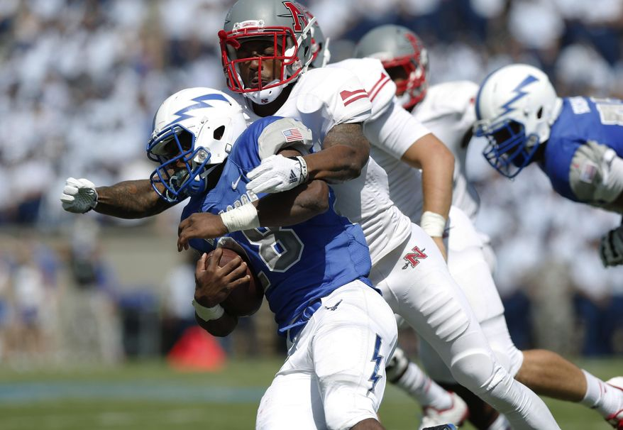Nicholls State defensive back Toren Joseph, back, wraps up Air Force running back Jacobi Owens as he carries the ball in the third quarter of an NCAA college football game at Air Force Academy, Colo., on Saturday, Aug. 30, 2014. (AP Photo/David Zalubowski)