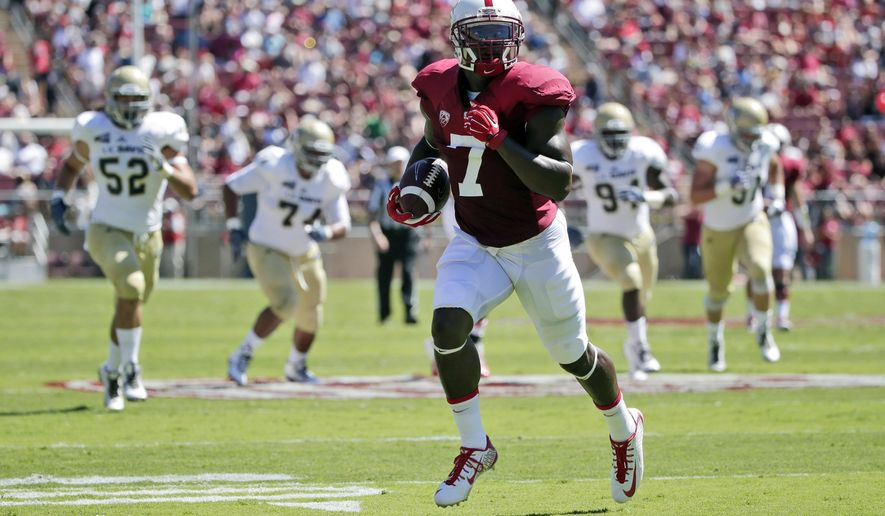 Stanford wide receiver Ty Montgomery runs into for a touchdown after a reception against UC Davis during the first half of an NCAA college football game on Saturday, Aug. 30, 2014, in Stanford , Calif. (AP Photo/Marcio Jose Sanchez)