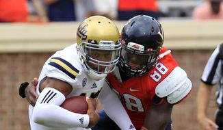 Virginia linebacker Max Valles (88) sacks UCLA quarterback Brett Hundley (17) during the first half of an NCAA college football game at Scott Stadium, Saturday, Aug. 30, 2014, in Charlottesville, Va. (AP Photo/Andrew Shurtleff)
