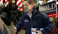 In this Nov. 5, 2012 photo, U.S. Rep. Bob Dold R-Ill., campaigns at a downtown Chicago commuter rail station during his unsuccessful re-election bid against Democrat Brad Schneider.  Schneider is running again to try an unseat Schneider in the November 2014 election. (AP Photo/Charles Rex Arbogast, File)