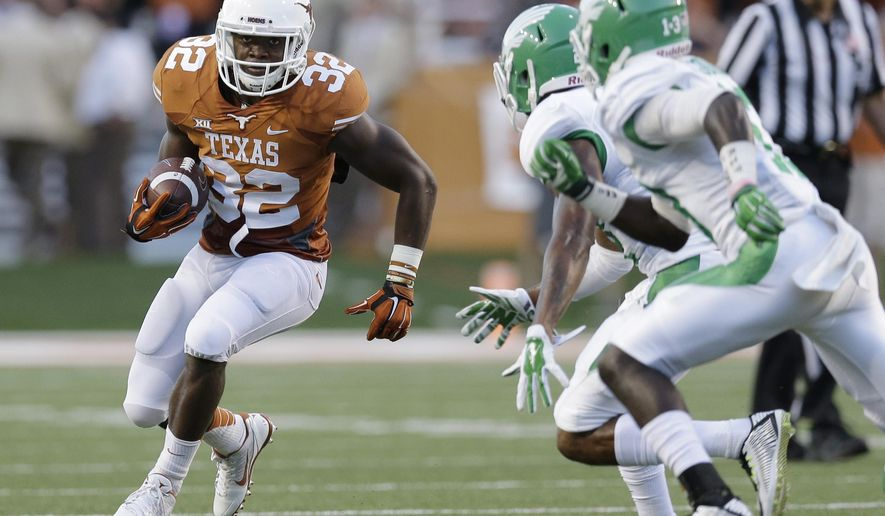 Texas' Johnathan Gray (32) races around North Texas defenders during the first half of an NCAA college football game, Saturday, Aug. 30, 2014, in Austin, Texas. (AP Photo/Eric Gay)