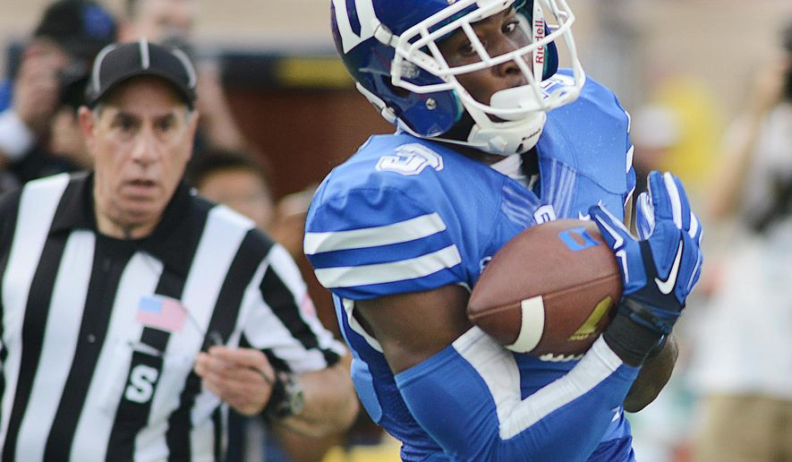 Duke's Jamison Crowder catches a pass for a 46-yard touchdown from quarterback Anthony Boone in the first half against Elon during an NCAA college football game Saturday, Aug. 30, 2014, in Durham, N.C. (AP Photo/The Herald-Sun, Bernard Thomas)