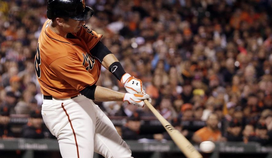 San Francisco Giants' Buster Posey drives in a run with a single against the Milwaukee Brewers during the second inning of a baseball game on Friday, Aug. 29, 2014, in San Francisco. (AP Photo/Marcio Jose Sanchez)