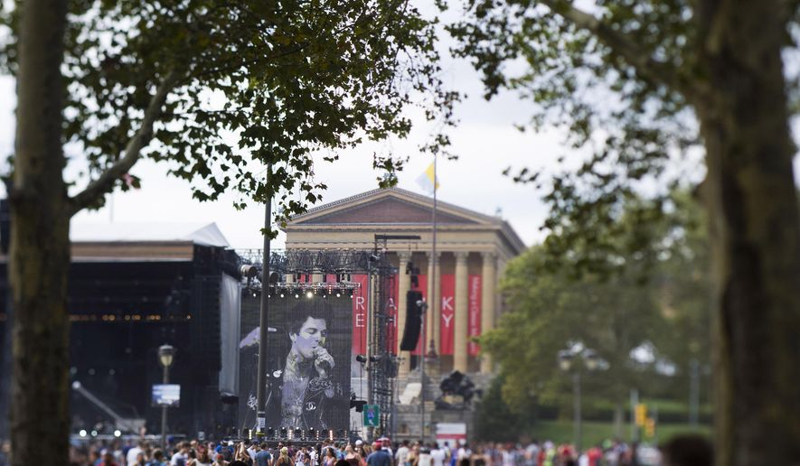 """The Neighbourhood performs on the """"Rocky"""" stage in front of the Philadelphia Museum of Art on day one of the Budweiser Made in America Festival on Saturday, Aug. 30, 2014, in Philadelphia. (Photo by Charles Sykes/Invision/AP)"""