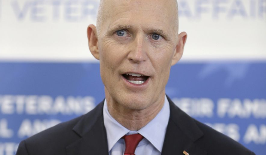 **FILE** Florida Gov. Rick Scott speaks to members of the media in Fort Lauderdale on April 29, 2014. (Associated Press)