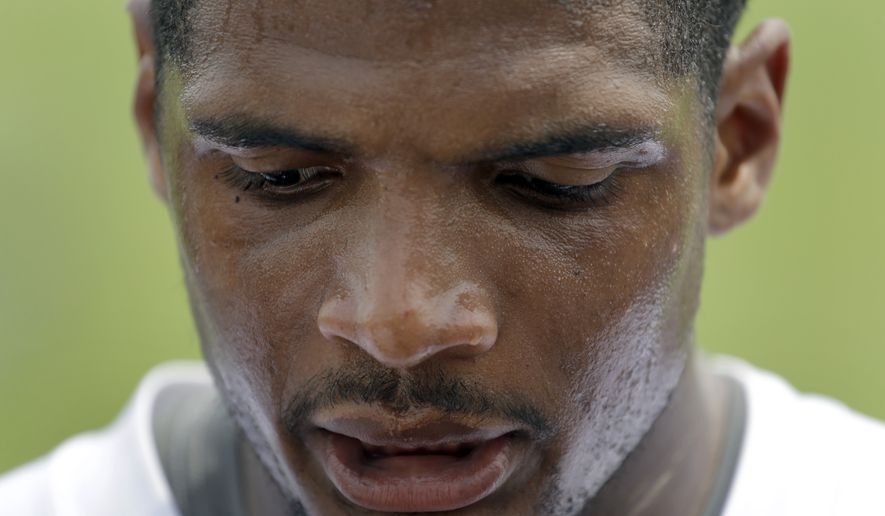 FILE - In this June 6, 2014, file photo, St. Louis Rams defensive end Michael Sam speaks to the media following an organized team activity at the NFL football team's practice facility in St. Louis. Sam, the first openly gay player drafted by an NFL team, was released by the Rams Saturday, Aug. 30, 2014. (AP Photo/Jeff Roberson, File)