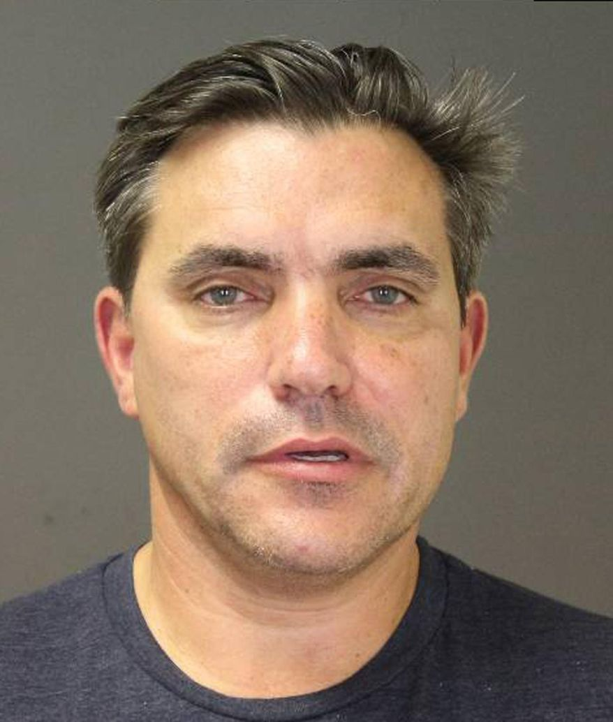 "CORRECTS AGE TO 54 This photo provided by the Southampton Town Police Department on Long Island shows celebrity chef Todd English, 54, after his arrest early Sunday morning, Aug 31, 2014 in Southampton, N.Y., where he was charged with driving while intoxicated. English has opened a number of restaurants around the country, including Olives, Figs, and Fish Club. He's also been a regular on television programs including ""Iron Chef USA."" Authorities say he posted $1,500 bail at Southampton Town Justice Court. (AP Photo/Southampton Town Police Department)"