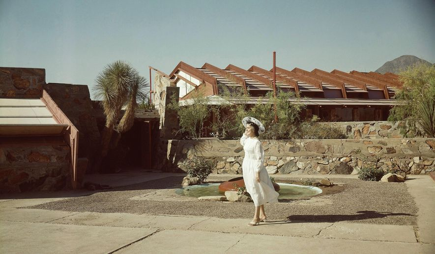 FILE - In this May 9, 1960 file photo, Mrs. Olgivanna Wright, wife of architect Frank Lloyd Wright, stands one of the architecture school buildings at Taliesen West, at Scottsdale, Ariz. The Frank Lloyd Wright School of Architecture's quest for a way to keep its accreditation status has some school board members at odds with the foundation operating it. Last week, the Scottsdale-based Frank Lloyd Wright Foundation announced it would not spin off the school into an independent corporation as a way to abide by new standards to gain accreditation. That decision has shaken the school's Board of Governors, who say that could mean the program would eventually become a shell of itself.  (AP Photo)