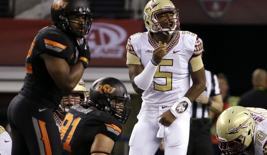 Florida State quarterback Jameis Winston (5) calls out at the line of scrimmage during the first half of an NCAA college football game against Oklahoma State, Saturday, Aug. 30, 2014, in Arlington, Texas. (AP Photo/Tony Gutierrez)