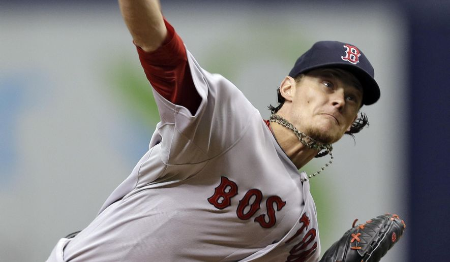 Boston Red Sox starting pitcher Clay Buchholz delivers to the Tampa Bay Rays during the fourth inning of a baseball game Sunday, Aug. 31, 2014, in St. Petersburg, Fla. (AP Photo/Chris O'Meara)