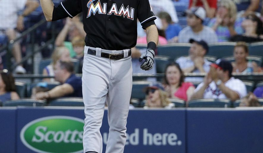 Miami Marlins' Christian Yelich reacts after striking out in the eighth inning of a baseball game against the Atlanta Braves, Sunday, Aug. 31, 2014, in Atlanta. (AP Photo/David Goldman)