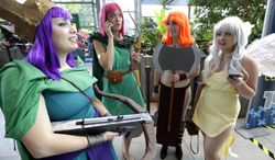 Dressed as characters with different battle skills from the video game Clash of Clans, from left, Liz Leo, Kristina Horner, Jenn Godwin and Eia Waltzer stand together Friday, Aug. 29, 2014, at the Penny Arcade Expo, a fan-centric celebration of gaming in Seattle. The event is expected to be attended by roughly 85,000 gamers and will include concerts, game tournaments and previews of upcoming titles. (AP Photo/Ted S. Warren)