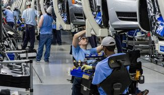 UNION SHOP: Volkswagen wants to implement labor policies, which have made Germany an economic powerhouse, at U.S. plants. (associated press)
