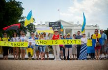 Ukraine supporters demonstrate in front of the White House. For the second time this year, President Obama heads to Russia's backyard, the Baltics, to assure nations there of his commitment to their security. (Associated Press)