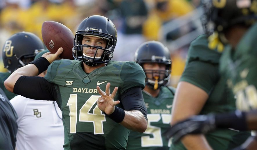 Baylor quarterback Bryce Petty (14) warms up before an NCAA college football game against SMU, Sunday, Aug. 31, 2014, in Waco, Texas. (AP Photo/LM Otero)