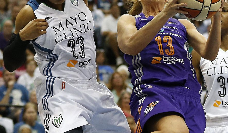 Phoenix Mercury forward Penny Taylor (13) tries to push up to the basket against Minnesota Lynx forward Maya Moore (23) during the first half of Game 2 of the WNBA basketball Western Conference finals, Sunday, Aug. 31, 2014, in Minneapolis. (AP Photo/Stacy Bengs)