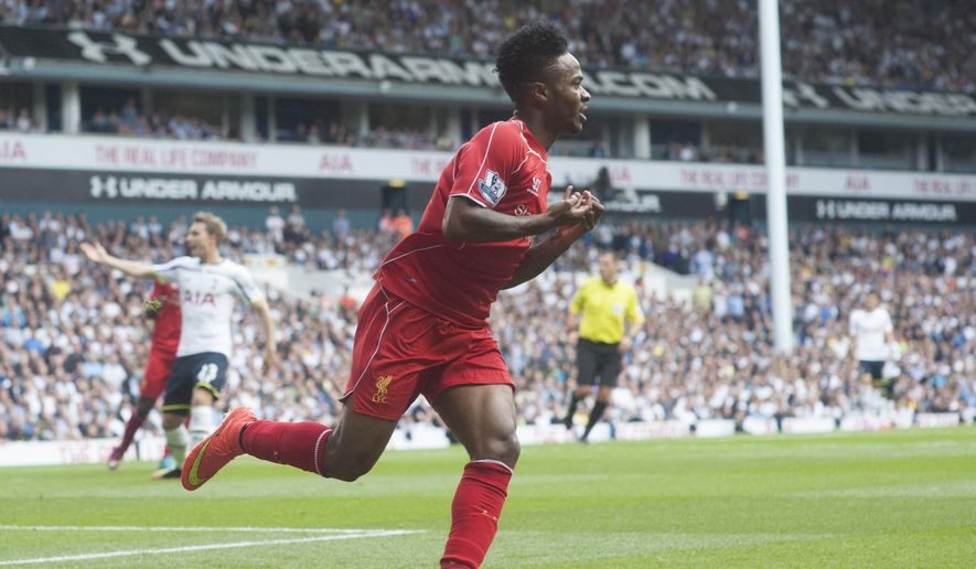 Liverpool's Raheem Sterling celebrates after scoring against Tottenham Hotspur, during their English Premier League soccer match at White Hart Lane, London, Sunday, Aug. 31, 2014 (AP Photo/Bogdan Maran)