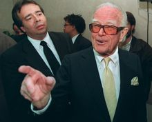 Washington Redskins owner Jack Kent Cooke talks with reporters during a news conference Monday, Dec. 4, 1995 in Landover, Md. Cooke announced plans to builda new 78,600 seat stadium for the Redksins in Landover. (AP Photo/Charles Tasnadi)
