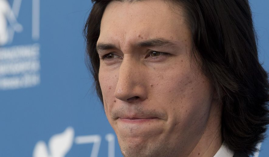 Actor Adam Driver poses during the photo call for the movie Hungry Hearts at the 71st edition of the Venice Film Festival in Venice, Italy, Sunday, Aug. 31, 2014. (AP Photo/David Azia)