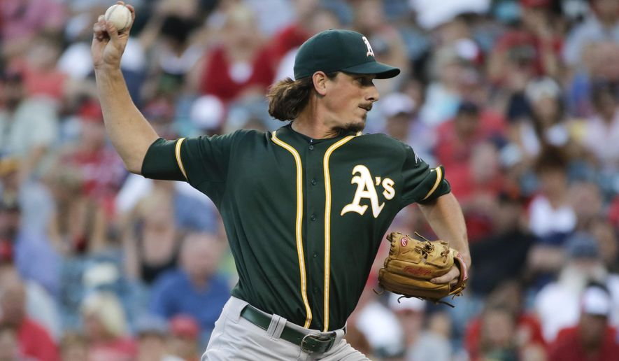 Oakland Athletics starting pitcher Jeff Samardzija throws against the Los Angeles Angels during the first inning of a baseball game Saturday, Aug. 30, 2014, in Anaheim, Calif. (AP Photo/Jae C. Hong)