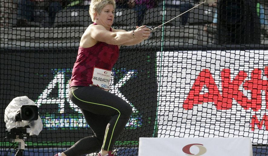 Anita Wlodarczyk from Poland throws the hammer during the women's hammer throw competition at the ISTAF Athletics Meeting in Berlin, Germany, Sunday, Aug. 31, 2014. Wlodarczyk set a new world record with 79.58 meters. (AP Photo/Michael Sohn)
