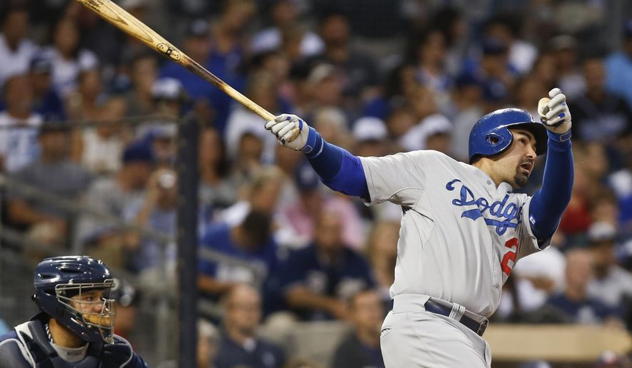 Los Angeles Dodgers' Adrian Gonzalez watches his solo home run blast head for the right field seats in the sixth inning of a baseball game against the San Diego Padres Saturday, Aug. 30, 2014, in San Diego.  (AP Photo/Lenny Ignelzi)