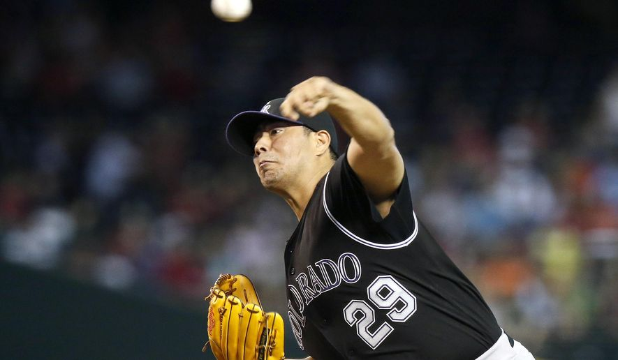Colorado Rockies' Jorge De La Rosa throws a pitch against the Arizona Diamondbacks during the first inning of a baseball game Sunday, Aug. 31, 2014, in Phoenix. (AP Photo/Ross D. Franklin)