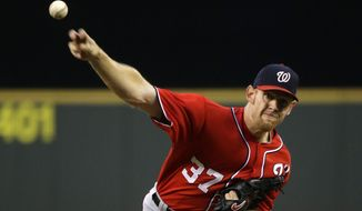 Washington Nationals starting pitcher Stephen Strasburg throws against the Seattle Mariners in the fourth inning of a baseball game, Saturday, Aug. 30, 2014, in Seattle. (AP Photo/Ted S. Warren)