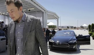 FILE - In this Friday, June 22, 2012 file photo, Tesla CEO Elon Musk walks past the Tesla Model S after a news conference at the Tesla factory in Fremont, Calif. Five states are on the short list for a $5 billion factory that Tesla Motors plans to build so it can crank out batteries for a new generation of electric cars. The package of economic incentives that each state offers will help determine where Tesla builds the factory — Nevada, California, Texas, Arizona or New Mexico. Tesla CEO Elon Musk has said the winning state will shoulder about 10 percent of the total cost, meaning at least $500 million worth of incentives.  (AP Photo/Paul Sakuma, File)