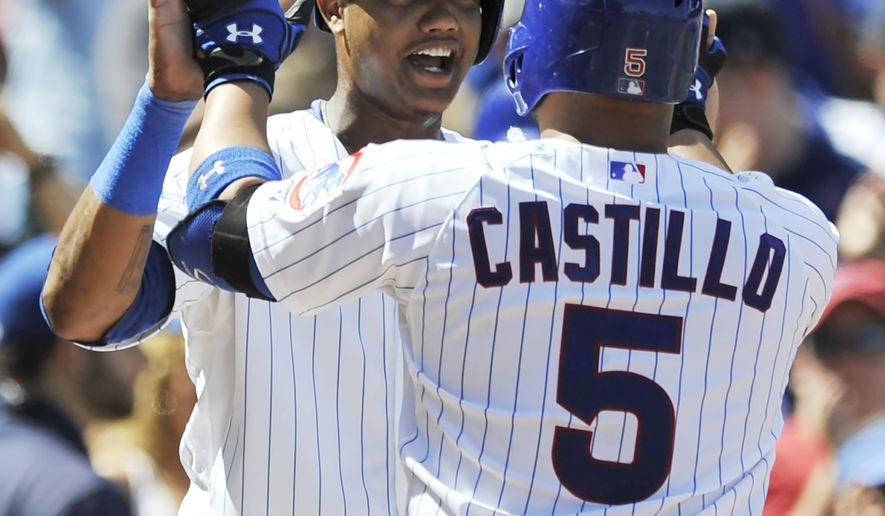 Chicago Cubs' Welington Castillo (5), celebrates with teammate Starlin Castro back, after hitting a two-run home run during the fourth inning of a baseball game against the Milwaukee Brewers in Chicago, Monday, Sept. 1, 2014. (AP Photo/Paul Beaty)
